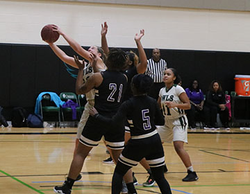 Women's basketball edges out Olive-Harvey College