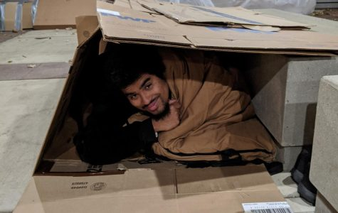 Students experiences life in cardboard homes.